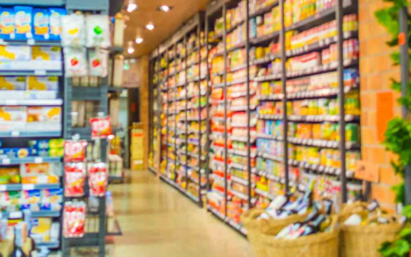 blurred image of  supermarket and variety product for background usage .