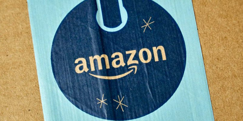 MONTREAL, CANADA - JANUARY 1, 2019: Amazon Prime holiday package with logo. Amazon, is an american technology company focusing on e commerce and cloud computing company,based in Seattle, WA